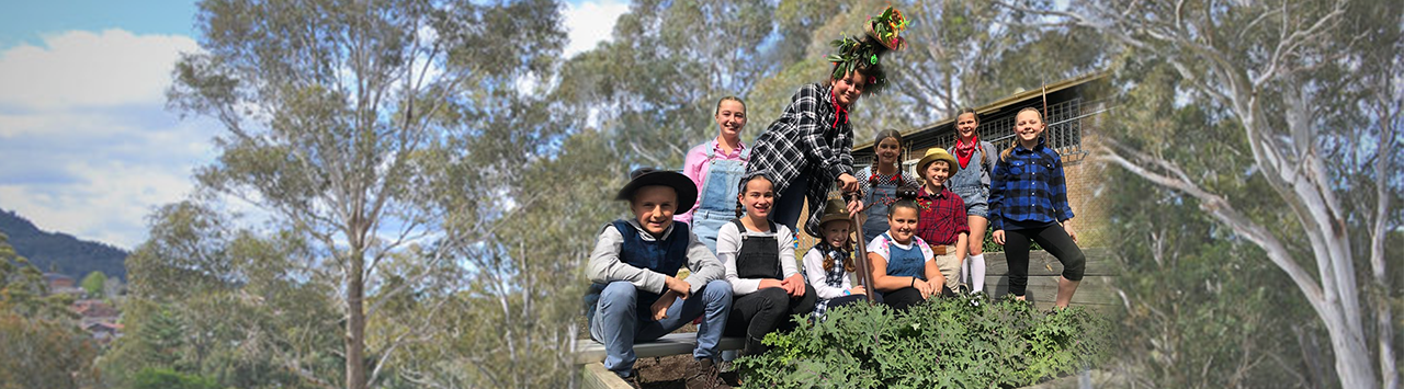 Students dressed in farming attire for 'fiver for a farmer' fundraiser.